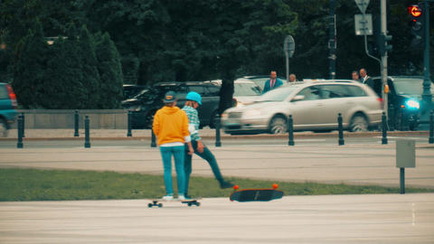 WARSAW, POLAND - SEPTEMBER 14, 2017. Girls riding skateboards on the street Footage