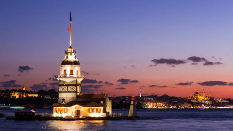 Timelapse of Maiden Tower or Kiz Kulesi with floating tourist boats on Bosphorus Footage