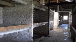 Beds for prisoners inside a barrack in Auschwitz concentration camp Live Action