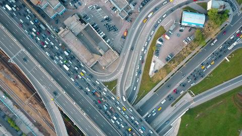 Aerial top down view of traffic jam on a city car road in the rush hour Fotografía
