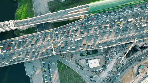 Congested road traffic and moving commuter train in the rush hour Footage