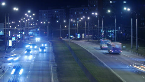 Time lapse, the light trails of city traffic on the building background Footage