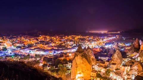 Pan Timelapse view of Goreme village in Cappadocia at night in Turkey Footage