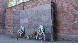 Wreaths under a death wall in Auschwitz concentration camp Footage