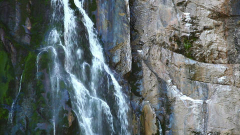 Waterfall, stream of water falling from a cliff Footage