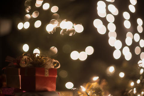 Christmas gift box and bokeh lights with copyspace Photo