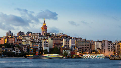 Day to night timelapse of Istanbul cityscape with Galata Tower and floating Footage