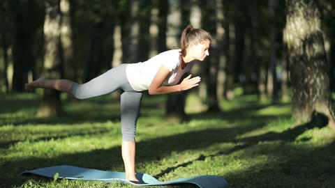[alt video] Woman practices yoga in the park