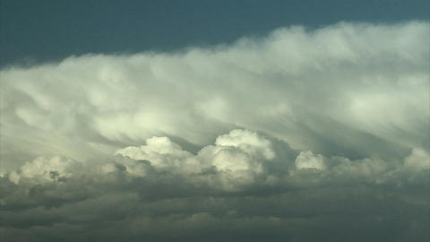 Clouds flowing together in the sky Footage