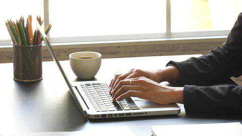 Hands typing keyboard,successful business woman working with laptop zoom in Footage