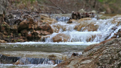 The river flows through a rocky rapids Footage