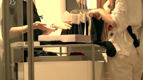 Female customer and sales assistant in the stockings store Footage