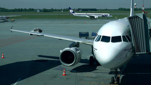 WARSAW, POLAND - MAY, 18, 2017. SAS Airbus airliner with attached jet bridge and Footage