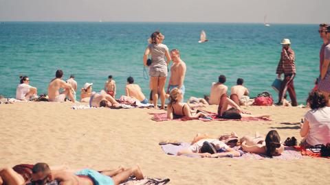 BARCELONA, SPAIN - APRIL, 15, 2017. Long steadicam shot of people sunbathing on Footage