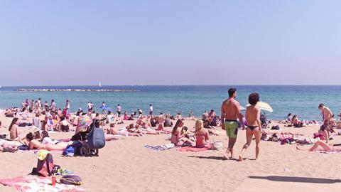 BARCELONA, SPAIN - APRIL, 15, 2017. Steadicam shot of people sunbathing on the Footage