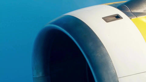 Airliner operating jet engine against blue sky Footage