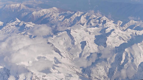 The Alps snowy peaks and clouds 4K video Footage
