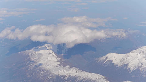 Beautiful cloud above the Alps snowy mountain peaks Footage