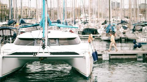 BARCELONA, SPAIN - APRIL, 15, 2017. Moored sailing catamaran and sailboats at Footage