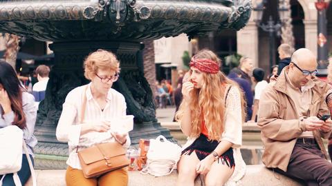 BARCELONA, SPAIN - APRIL, 16, 2017. Female tourists saving money eating food Footage