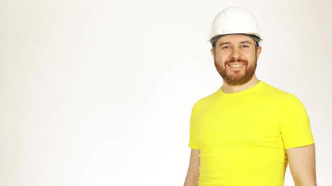Portrait of handsome smiling construction engineer or architect in yellow tshirt Footage