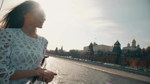 Brunette woman in white dress looking at Moscow Kremlin Footage