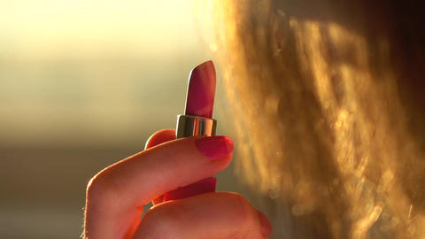 Young woman opens new pink lipstick Filmmaterial