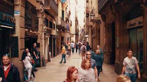BARCELONA, SPAIN - APRIL, 15, 2017. Overhead steadicam shot of tourists walking Footage