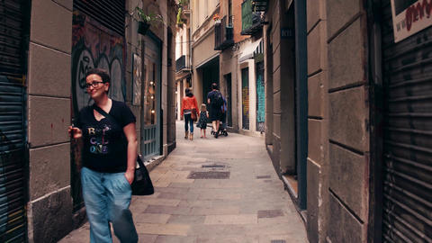 BARCELONA, SPAIN - APRIL, 15, 2017. Steadicam shot of tourists walking along Footage