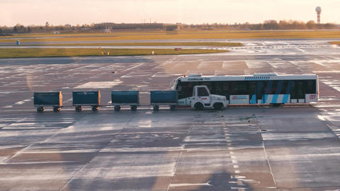 WARSAW, POLAND - APRIL, 14, 2017. Airport utility vehicles driving on the Footage