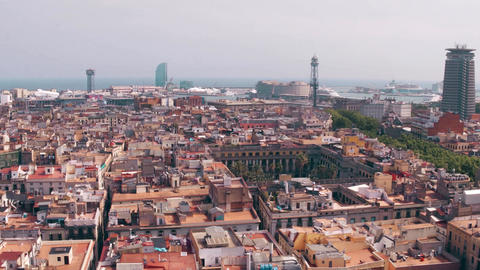 Barcelona rooftops and distant seaport Spain Footage