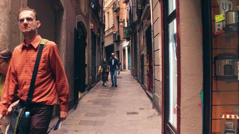 BARCELONA, SPAIN - APRIL, 15, 2017. Tourists walk along narrow pedestrian old Footage