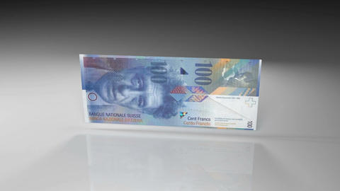 Close up of Swiss franc banknote in rotation view on a glossy surface Animation