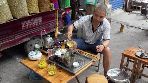 Chinese Man Serving And Selling Tea At Market Guilin China Filmmaterial