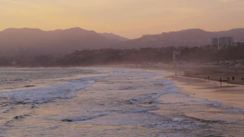 Waves coming in at sunset on california beach Live Action