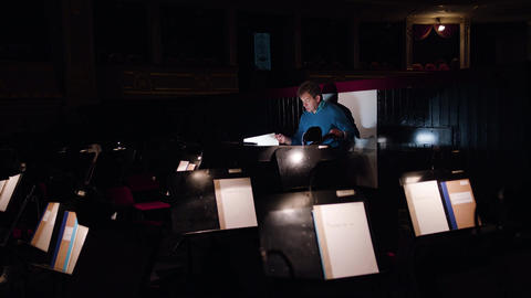 Conductor in an Orchestra Pit Studies Sheet Music Image