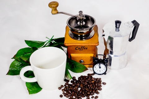 Coffee cup, alarm clock, coffee grinder and boiler Photo