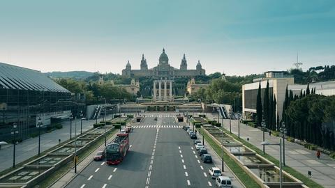 BARCELONA, SPAIN - APRIL, 15, 2017. Aerial shot of tour bus and Palau Nacional - フォト
