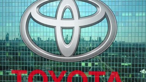 Aerial shot of office skyscraper with Toyota logo. Modern office building Live Action