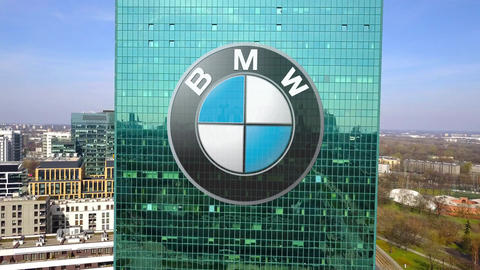 Aerial shot of office skyscraper with BMW logo. Modern office building Live Action