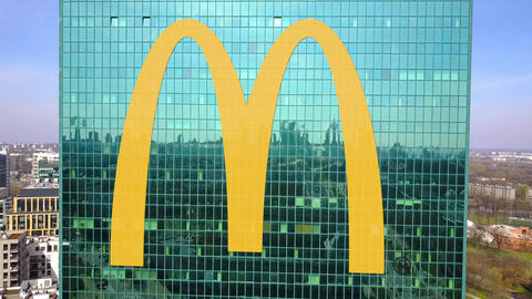 Aerial shot of office skyscraper with McDonald's logo. Modern office building Footage