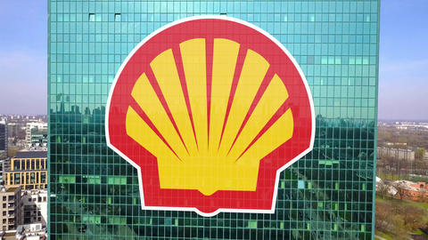 Aerial shot of office skyscraper with Shell Oil Company logo. Modern office Live Action