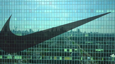 Aerial shot of office skyscraper with Nike inscription and logo. Modern office Live Action