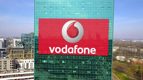 Aerial shot of office skyscraper with Vodafone logo. Modern office building Footage