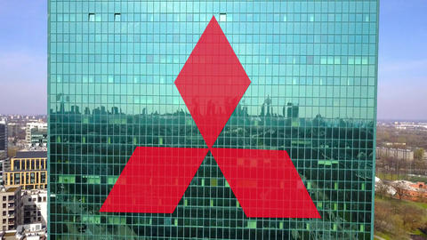 Aerial shot of office skyscraper with Mitsubishi logo. Modern office building Footage