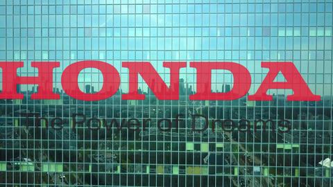 Aerial shot of office skyscraper with Honda logo. Modern office building Live Action