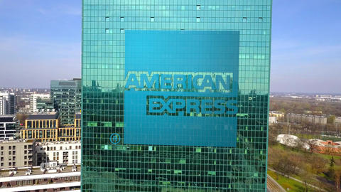 Aerial shot of office skyscraper with American Express logo. Modern office Live Action