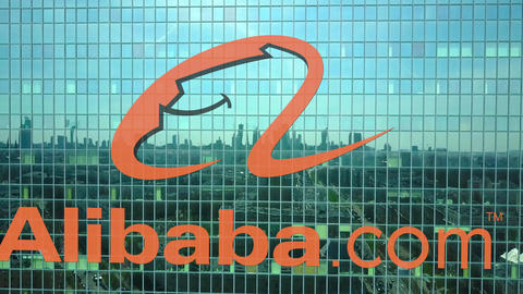 Aerial shot of office skyscraper with Alibaba.com logo. Modern office building Live Action