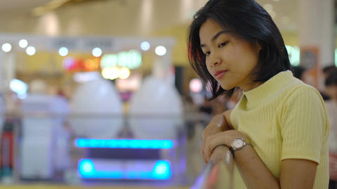 Smiling pretty Asian Woman in shopping mall Footage