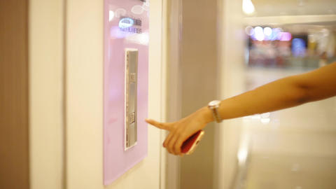 Female finger pressing button of elevator in shopping mall Footage